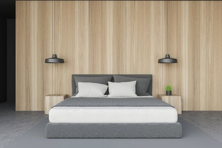 Interior of minimalistic bedroom with wooden and gray walls, concrete floor with gray carpet, comfortable king size bed and two bedside tables with lamps above them. 3d rendering