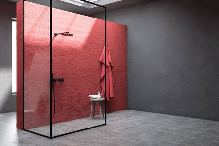 Corner of stylish bathroom with red and gray walls, concrete floor, shower stall with glass walls and chair with towels and bottles. 3d rendering