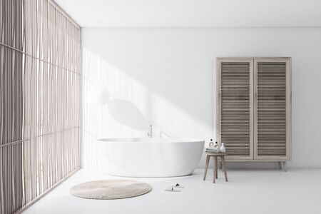 Interior of comfortable bathroom with white walls and floor, light wooden blinds, comfortable white bathtub with round carpet and wooden wardrobe. 3d rendering