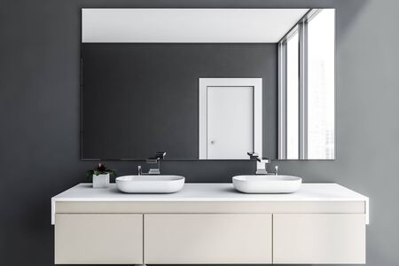 Close up of double bathroom sink standing on beige countertop in room with gray walls and large mirror. 3d rendering