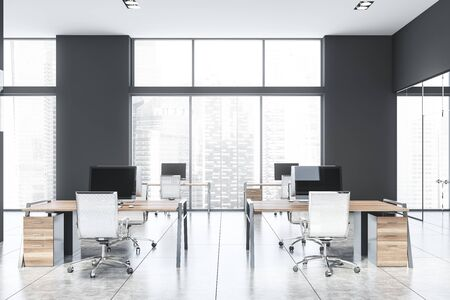 Interior of spacious open space office with gray walls, tiled floor and rows of wooden computer desks. Window with cityscape. 3d rendering