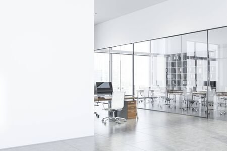 Interior of stylish open space office with white walls, open space area and meeting room in background. Mock up wall on the left. 3d rendering Stockfoto