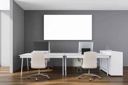 Interior of minimalistic open space office with gray walls, wooden floor, white computer tables with white chairs and horizontal mock up poster. 3d rendering Stockfoto