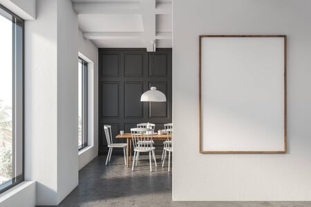 Interior of minimalistic and trendy dining room with gray and white walls, concrete floor, wooden table with white chairs and stylish lamp. Vertical mock up poster frame in foreground. 3d rendering