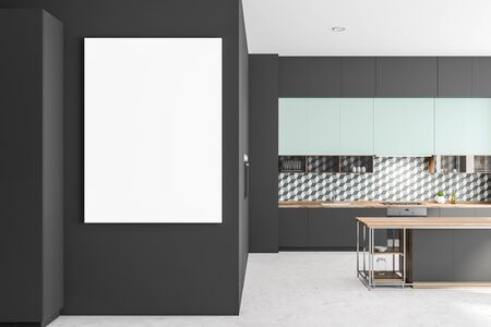 Interior of stylish kitchen with geometric pattern wall, concrete floor, gray countertops with built in sink and oven, blue cupboards and gray island. Vertical mock up poster. 3d rendering