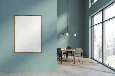 Interior of minimalistic loft dining room with blue walls, concrete floor and wooden table with gray chairs standing on beige carpet. Vertical mock up poster frame in foreground. 3d rendering