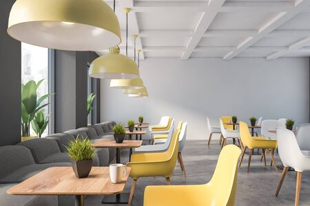 Interior of family restaurant with gray and white walls, stone floor, gray sofas and yellow and white chairs near square wooden tables. 3d rendering