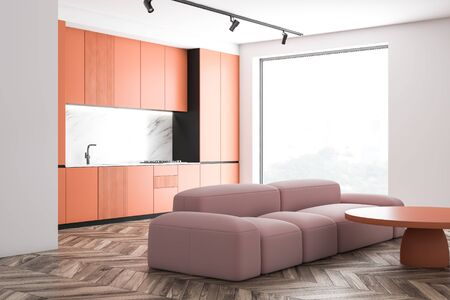 Corner of stylish kitchen with white and marble walls, wooden floor, orange countertops and cupboards and comfortable pink sofa near coffee table. 3d rendering