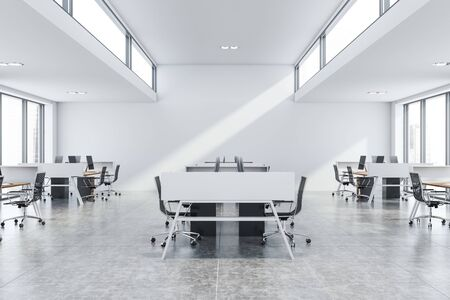Interior of modern open space office with tiled floor, white walls, rows of wooden computer tables with black chairs and windows near the ceiling. 3d rendering
