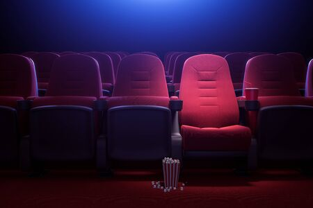 Interior of empty dark cinema with rows of red seats with cup holders and popcorn. Concept of entertainment. 3d rendering toned image Imagens