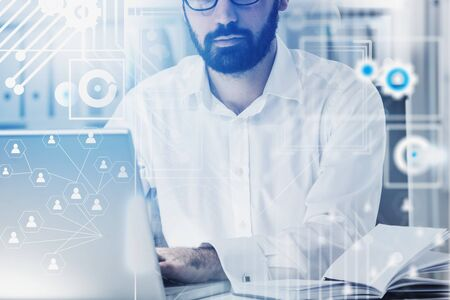 Serious bearded HR manager working in office. Double exposure of social network interface. Concept of HR and recruitment. Toned image