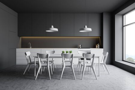 Interior of stylish kitchen with gray walls, concrete floor, white countertops with sink and cooker, gray cupboards and comfortable white dining table with chairs. 3d rendering Stockfoto