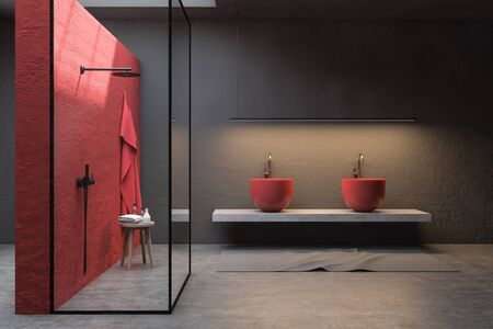 Interior of stylish bathroom with red and gray walls, concrete floor, shower stall with glass walls, double sink and chair with towels and bottles. 3d rendering
