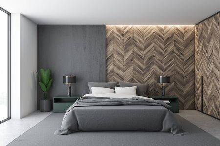 Interior of stylish bedroom with white, gray and wooden walls, concrete floor, master bed with green bedside table and stylish lamps and wooden wardrobe. 3d rendering Stockfoto