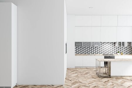 Interior of stylish kitchen with geometric pattern wall, wooden floor, white countertops with built in sink and oven, white cupboards and island. Mock up wall to the left. 3d rendering