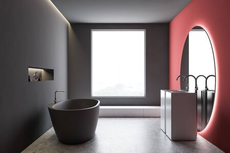 Interior of stylish bathroom with gray and red walls, concrete floor, comfortable grey bathtub and double sink with large round mirror. 3d rendering