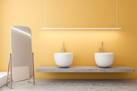 Interior of comfortable bathroom with yellow walls, concrete floor, massive double sink standing on stone shelf and vertical mirror on the floor. 3d rendering