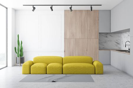 Interior of stylish kitchen with white and marble walls, concrete floor, white countertops, wooden cupboard and comfortable yellow sofa near gray carpet. 3d rendering