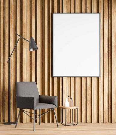 Interior of minimalistic living room with wooden walls and floor, comfortable gray armchair with floor lamp near round coffee table and vertical mock up poster. 3d rendering 写真素材