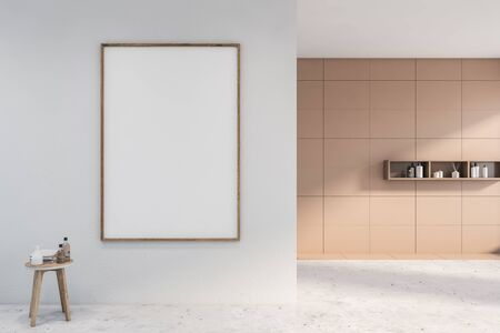 Interior of empty spacious spa bathroom with white and beige tile walls, concrete floor, stylish shelves with soap and shampoo and chair with towels. Vertical mock up poster frame. 3d rendering