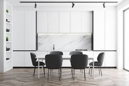 Interior of minimalistic luxury kitchen with marble walls, wooden floor, white countertops with built in cooker and sink and white cupboards. Comfortable dining table with gray chairs. 3d rendering