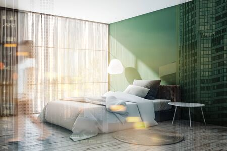 Young woman walking in stylish bedroom with green walls, comfortable bed with white blanket and bedside table. Toned image double exposure blurred Banco de Imagens