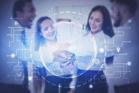 Happy diverse business team in office with double exposure of planet hologram and network interface. Concept of teamwork and hi tech startup. Toned image blurred Zdjęcie Seryjne