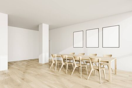 Interior of modern dining room with white walls, wooden floor, columns and long wooden table with three vertical mock up posters. 3d rendering 写真素材