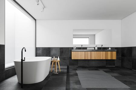 Side view of panoramic bathroom with white and tiled walls, tiled floor, comfortable bathtub and double sink on wooden counter with large mirror. 3d rendering