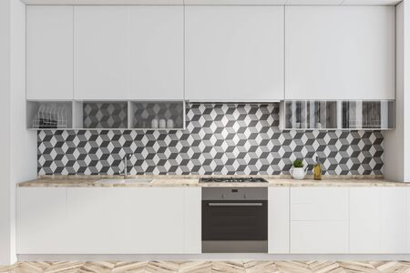 Interior of minimalistic kitchen with geometric pattern walls, wooden floor, white countertops with built in oven, cooker and sink and white cupboards. 3d rendering