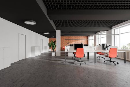 Interior of stylish open space office with bright orange geometric pattern walls and rows of white computer tables with orange chairs. Row of white doors. 3d rendering