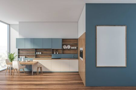 Interior of modern kitchen with white and blue walls, wooden floor, white countertops, blue cupboards, two built in ovens and stylish table with white chairs. Vertical mock up poster. 3d rendering