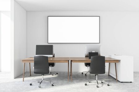 Interior of minimalistic open space office with white walls, concrete floor, wooden computer tables with black chairs and horizontal mock up poster frame. 3d rendering Stock Photo