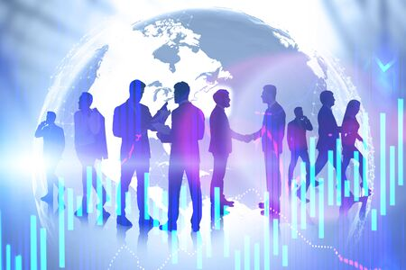 Silhouettes of business people shaking hands and communicating over planet background with double exposure of graphs. International partnership. Toned image. Elements of this image furnished by NASA