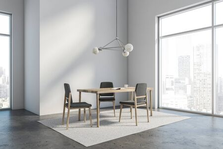 Corner of minimalistic loft dining room with white walls, concrete floor and wooden table with gray chairs standing on white carpet. 3d rendering