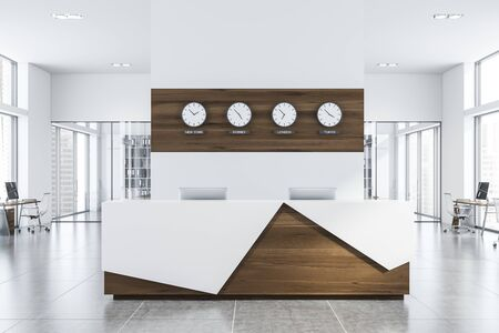 Interior of modern open space office with white walls, tiled floor, rows of computer tables and white and wooden reception table with clocks above it. 3d rendering Standard-Bild - 128826445