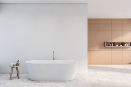 Interior of spacious bathroom with white and beige tile walls, concrete floor, comfortable white bathtub, shelves with shampoo. Concept of spa. 3d rendering Zdjęcie Seryjne