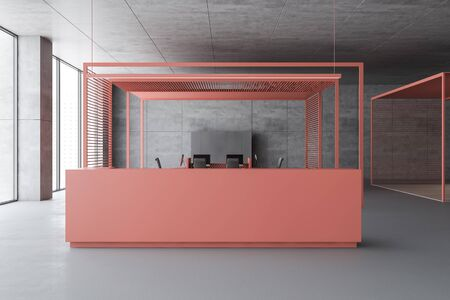 Stylish pink reception desk standing in modern office with concrete walls and open space area with computers. 3d rendering