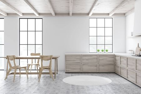 Interior of stylish kitchen with white walls, tiled floor, wooden countertops and dining table with comfortable chairs. Round carpet on the floor. 3d rendering