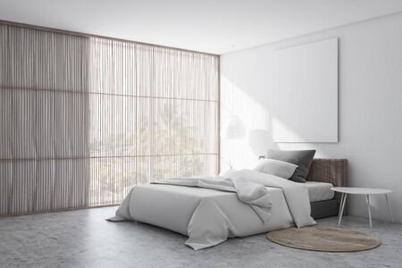 Corner of stylish bedroom with white walls, concrete floor with carpet, comfortable bed with white blanket and vertical mock up poster. Window with blinds. 3d rendering Stockfoto