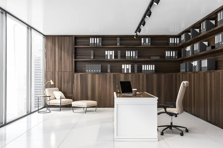 Interior of luxury panoramic CEO office with white tile floor, wooden bookcase with folders, comfortable table with laptop and lounge area with beige armchair. 3d rendering