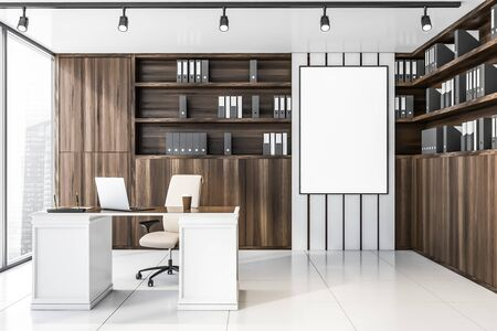 Interior of luxury CEO office with white tile floor, wooden bookcase with folders, comfortable table with laptop and beige armchair. Vertical mock up poster on wall. 3d rendering