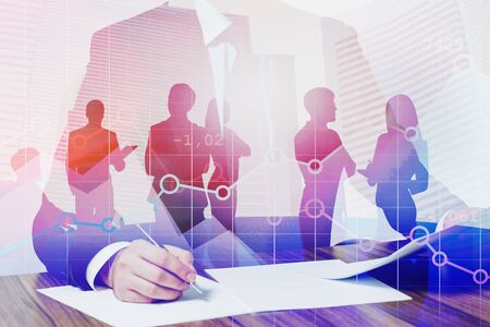 Businessman signing document in modern city with double exposure business people and digital graphs. Concept of leadership and stock market. Toned image