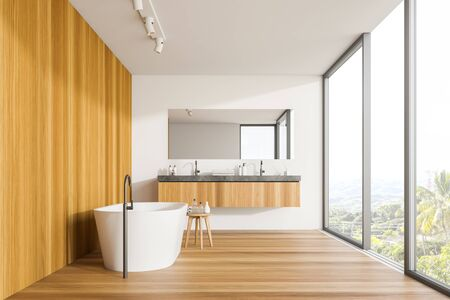 Interior of panoramic bathroom with white and wooden walls, wooden floor, comfortable bathtub, double sink and window with magnificent scenery. 3d rendering