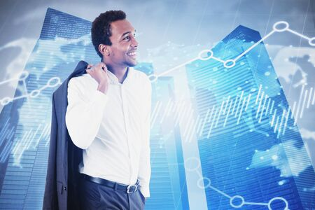Cheerful African American businessman standing in modern city with double exposure of graphs and world map. Concept of stock market and international business. Toned image Zdjęcie Seryjne