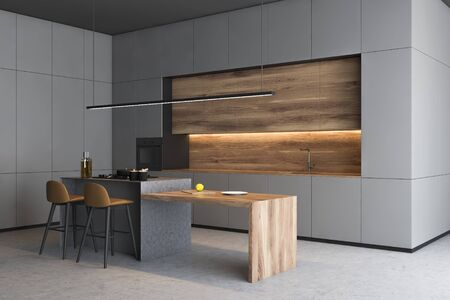 Corner of modern kitchen with gray walls, concrete floor, grey countertops, wooden cupboards and wooden bar with stools. 3d rendering 写真素材