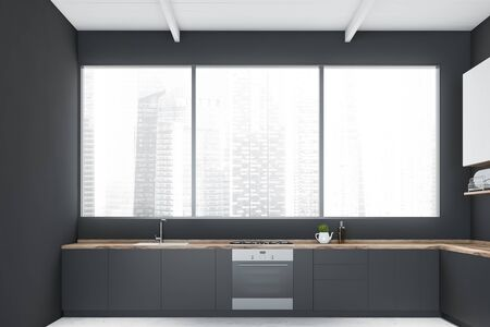 Interior of minimalistic kitchen with gray walls, concrete floor, panoramic window with cityscape, grey countertops and white cupboards. 3d rendering