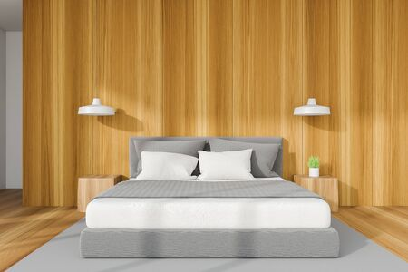 Interior of minimalistic bedroom with wooden and white walls, wooden floor with gray carpet, comfortable king size bed and two bedside tables with lamps above them. 3d rendering Stock Photo