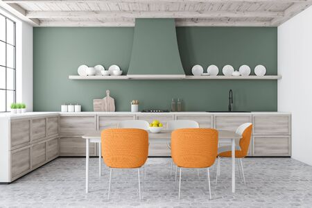 Interior of stylish kitchen with green and white walls, tiled floor, wooden countertops and dining table with orange chairs. Shelves with plates. 3d rendering 写真素材