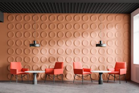 Orange modern office waiting room with geometric pattern walls, concrete floor, bright orange armchairs and white round coffee tables. 3d rendering Reklamní fotografie